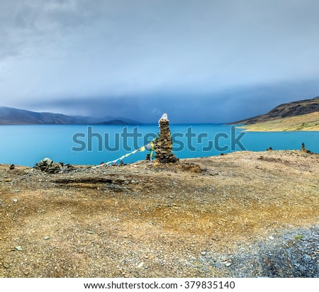 Nice view of the Tso Moriri lake near Karzok village in Rupshu valley against the background of cloudly sky - Tibet, Leh district, Ladakh, Himalayas, Jammu and Kashmir, Northern India - stock photo