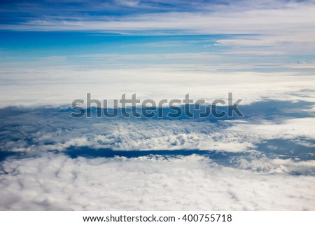 Nice view seen from the airplane; cloud carpet and blue sky - stock photo