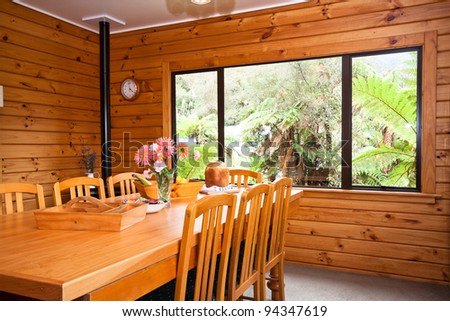 Nice warm interior of mountain wooden lodge dining room. Fox Glacier Lodge, Fox Glacier, West Coast, South Island, New Zealand. - stock photo