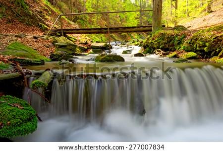 Nice waterfall on mountain river - stock photo