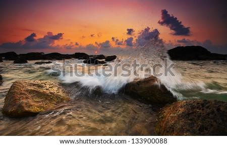 Nice waves at sunset time in Sri Lanka, Hikkaduwa. - stock photo