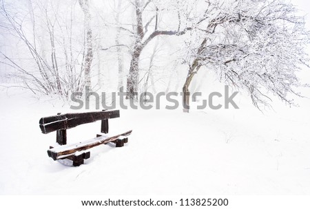Nice winter scene with bench - stock photo