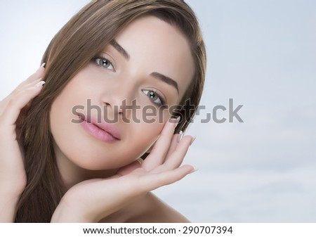 Nice woman face and hands - stock photo