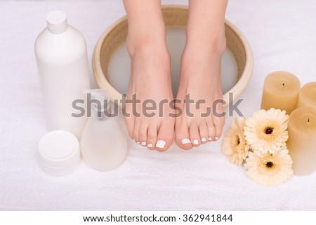 Nice woman having foot treatment  - stock photo