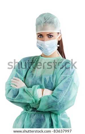 nice woman in green surgery dress with cap mask and gloves