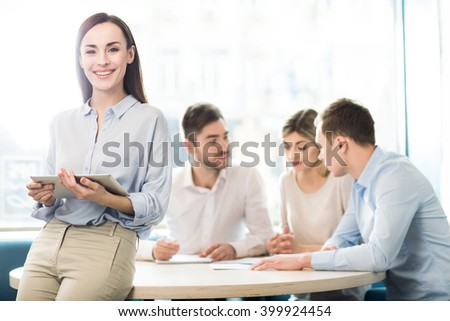 Nice woman working in the office - stock photo