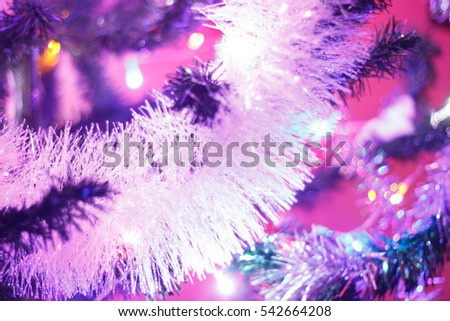 Nice xmas tree lights in tree,Christmas tree background and Christmas decorations with snow, blurred, sparking, glowing. Happy New Year and Xmas theme.