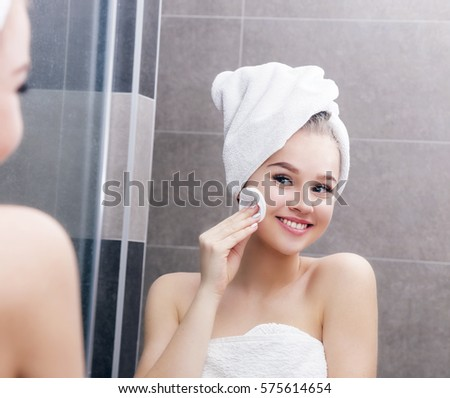 Nice yang girl with cotton pad in mirror