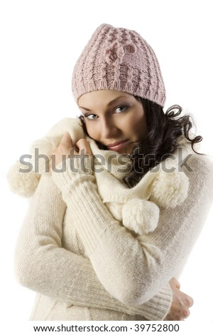 nice young brunette with a white sweater and pink hat in a studio shot on white - stock photo