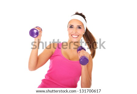 Nice young girl holding weights