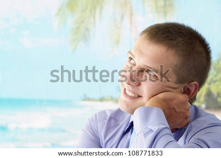 Nice young guy with short hair at the beach