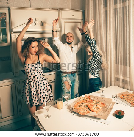 Nice young people dancing at pizza party. Celebrate, disco, party, nightlife, entertainment, friendship concept. - stock photo