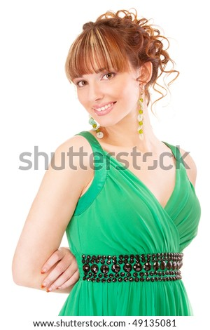 Nice young woman in green dress, isolated on white background.