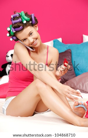 nice young woman smiling and preparing herself for party - stock photo
