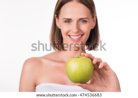 Nice young woman with apple