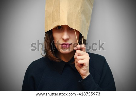 Nice young woman with the paper bag on the head.