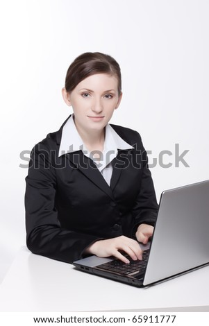 nice young woman works with notebook on a white background