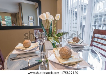 Nicely decorated and served living ( lunch ) room table. Interior design. - stock photo