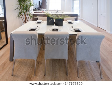 Nicely decorated and served living, lunch room table with the coffee, tea set and decorative vases. Interior design. - stock photo