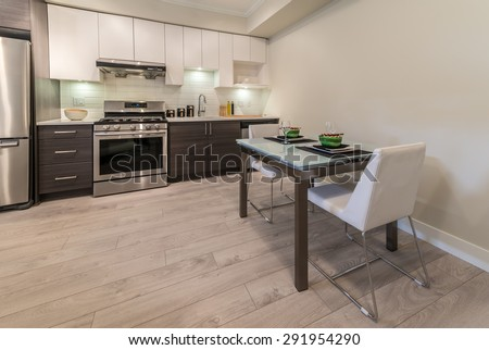 Nicely decorated dining table in the  luxury modern kitchen.  Interior design. - stock photo