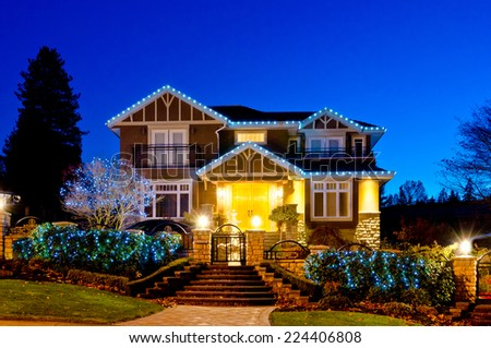 Nicely decorated  house in suburbs of Vancouver at dusk, night time.  Canada. - stock photo