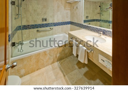 Nicely decorated modern washroom with the toilet and towels in the luxury  hotel. Interior design