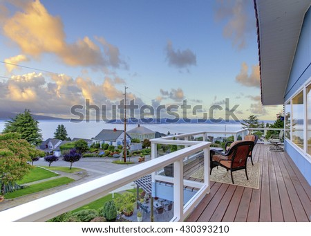 Nicely furnished screened deck overlooking beautiful scenery - stock photo