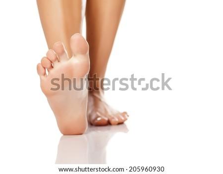 nicely nursed women's feet on white background - stock photo