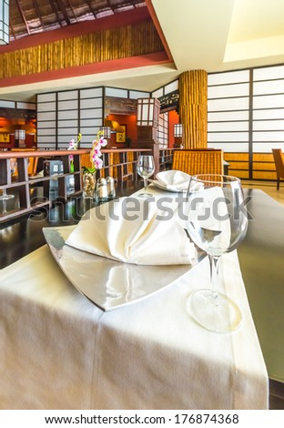 Nicely served table with napkin in oriental style interior of the japanese restaurant of the luxury five stars caribbean resort. Bahia Principe, Riviera Maya. - stock photo