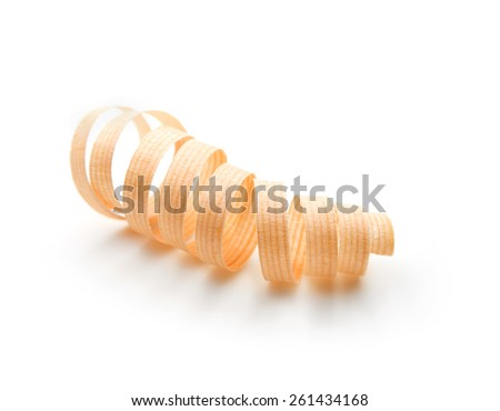 Nicely shaped thin wood shaving isolated on white. Shallow depth of field.  - stock photo