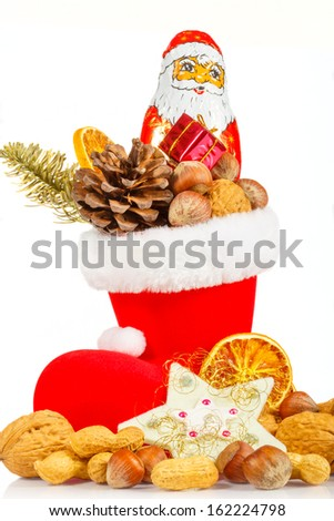 Nicholas Boot with nuts on white background - stock photo