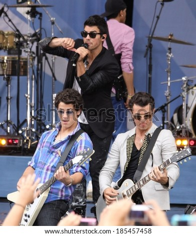 Nick Jonas, Joe Jonas, Kevin Jonas, The Jonas Brothers, on stage for Good Morning America GMA Concert Series with The Jonas Brothers, Rumsey Playfield in Central Park, New York August 13, 2010 - stock photo