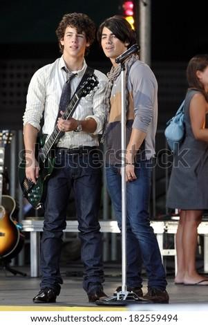 Nick Jonas, Joe Jonas on stage for The Jonas Brothers in Concert on ABC's Good Morning America, Bryant Park, New York, NY, August 08, 2008 - stock photo