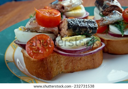 Nicoise toast - sandwiches with eggs, fish and cherry tomatoes