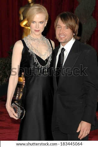 Nicole Kidman, in a Baleciaga dress, L'Wren Scott necklace and carrying a Bottega Veneta clutch, Keith Urban at RED CARPET-80th Annual Academy Awards Oscars Ceremony, LA, Febr 24, 2008 - stock photo