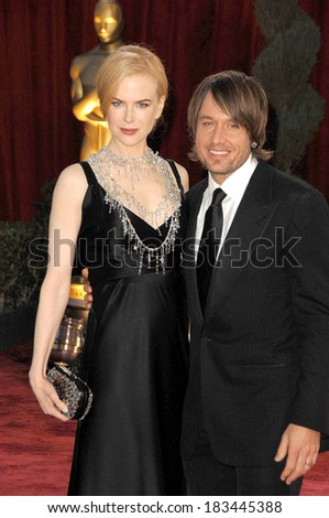 Nicole Kidman, in Balenciaga dress, L'Wren Scott necklace, Bottega Veneta clutch, Keith Urban at 80th Annual Academy Awards Oscars Ceremony, The Kodak Theatre, LA, Febr 24, 2009 - stock photo