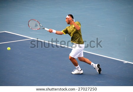 NICOSIA, CYPRUS - MARCH 8 :  Davis Cup Tournament with Markos Pagdatis in action in Nicosia, Cyprus on March 8, 2009. The first Davis Cup tie takes place in 1900 in Boston, USA. - stock photo