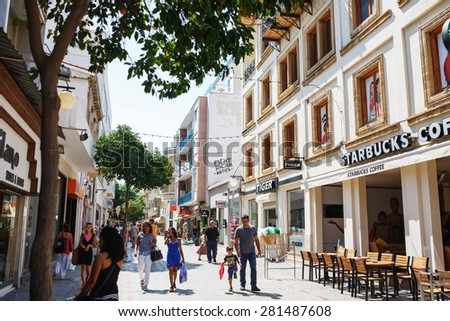 NICOSIA, CYPRUS - SEPTEMBER, 14, 2014 : People walking on Ledra street in Nicosia, Cyprus. The major shopping thoroughfare in central Nicosia, Cyprus, which links North Nicosia. - stock photo