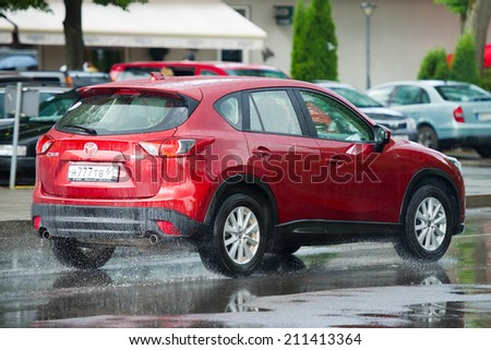 NIDA - JULY 14: Mazda CX-5 on July 14, 2014 in Nida, Lithuania. The Mazda CX-5 is a compact crossover SUV produced by Mazda starting in 2012 for the 2013 model year lineup.  - stock photo
