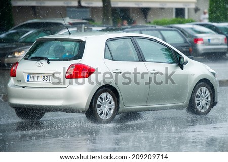 NIDA - JULY 14: Toyota Auris on July 14, 2014 in Nida, Lithuania. The Toyota Auris is a compact hatchback derived from the Toyota Corolla. Introduced in 2006.  - stock photo