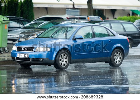 NIDA, LITHUANIA - JULY 14 : Audi A4 (B6) on July 14, 2014 in Nida, Lithuania. The Audi A4 is a line of compact executive cars produced since late 1994 by the German car manufacturer Audi. - stock photo