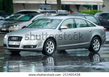 NIDA, LITHUANIA - JULY 14 : Audi a6 Quattro (C6) on July 14, 2014 in Nida, Lithuania. The Audi A6 is an executive mid-size car made by the German automaker Audi AG.  - stock photo