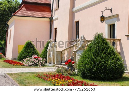 NIEPOLOMICE,POLAND - JULY 05, 2015: Stone monuments of medieval knights in gardens of royal castle in Niepolomice, Poland