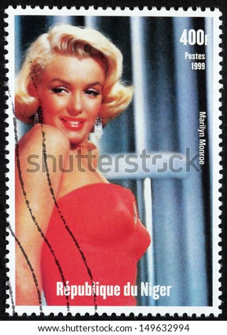 NIGER - CIRCA 1999: A postage stamp printed by Niger shows image portrait of famous American actress, model and singer Marilyn Monroe (1926-1962), circa 1999. - stock photo