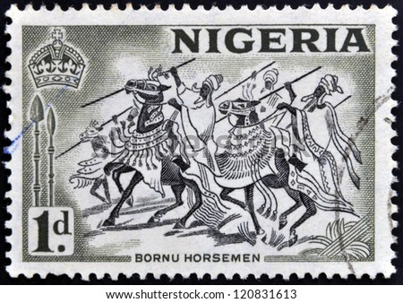 NIGERIA - CIRCA 1946: A stamp printed in Nigeria shows image of Bornu horsemen, circa 1946