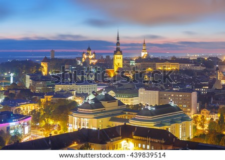 Night aerial cityscape with Medieval Old Town illuminated with Saint Nicholas Church, Cathedral Church of Saint Mary and Alexander Nevsky Cathedral in Tallinn, Estonia - stock photo
