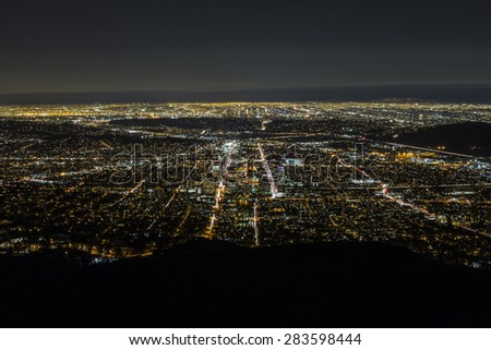Night aerial of Glendale and downtown Los Angeles in Southern California. - stock photo