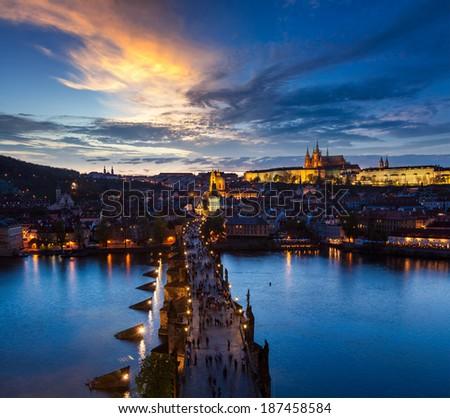 Night aerial view of Prague castle and Charles Bridge over Vltava river in Prague, Czech Republic. Prague, Czech Republic - stock photo