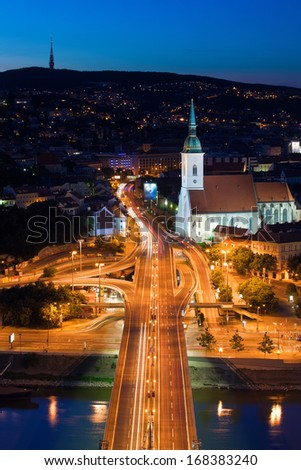 Night auto traffic with cars and buses in Bratislava, Slovakia