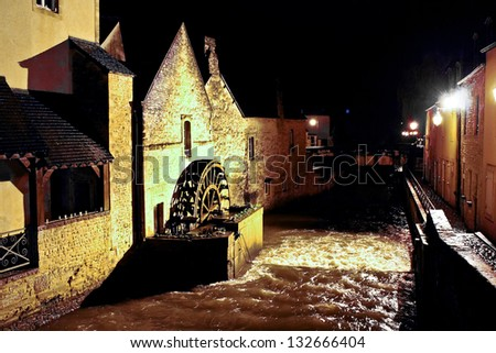 Night Bayeux. Old mill on the river city. Normandy - stock photo